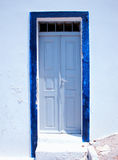 Traditional greek door on Santorini island, Greece. Traditional greek white and blue door on Santorini island, Greece Royalty Free Stock Images