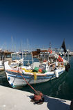Traditional Greek fishing boat. Moored at the quay Stock Photos