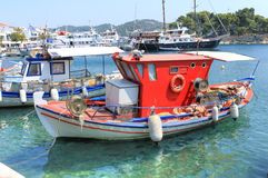 Traditional Greek fishing boat. Fishing boat in port of Skiathos, Greece Stock Photography