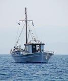 Traditional Greek fishing boat. Sailing in the Aegean sea, nearby the coastline of Skiathos - Greece Stock Photo