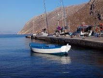 Traditional Greek fishing boat in the Aegean stock images