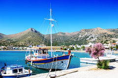The traditional Greek fishing boat near pier Royalty Free Stock Photography