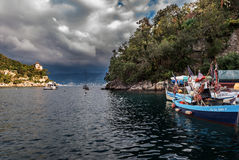 Traditional Greek fishing boats at harbor of Portofino town, Italy Royalty Free Stock Images