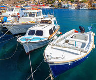 Traditional Greek fishing boats in harbour at Symi Town in Dodecanese Greece Europe Royalty Free Stock Image