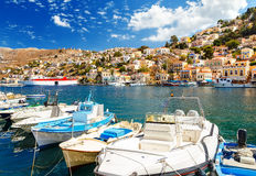 Traditional Greek fishing boats in harbour at Symi Town in the Dodecanese Greece Europe Royalty Free Stock Image