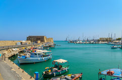 Traditional Greek fishing boats are located at Heraklion Royalty Free Stock Photo