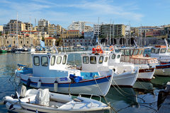 The traditional Greek fishing boats are near pier Royalty Free Stock Photo