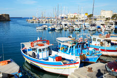 The traditional Greek fishing boats are near pier Stock Images