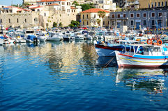 The traditional Greek fishing boats are near pier Stock Photo