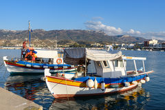 Traditional Greek fishing boats near pier of Sitia town on Crete island Royalty Free Stock Images