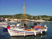 Traditional Greek fishing boats in port Stock Photo