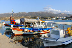 Traditional Greek fishing boats at port of sitia town on Crete island Stock Images