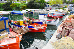 Traditional Greek fishing harbour with boats white houses Stock Photo