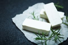 Traditional Greek food is feta cheese on a black background. Space for text stock images