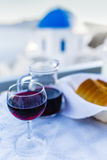 Traditional Greek food and homemade red wine Stock Photography