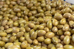 Traditional greek food ingredient, green olives in box on farmer market. Close up royalty free stock images