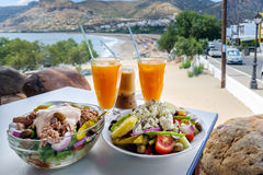 Traditional Greek food and orange juice.  Royalty Free Stock Photos