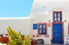 Traditional Greek house with blue door and windows, Santorini Royalty Free Stock Photos