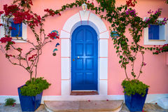 Traditional Greek House With Blue Door And Windows. Assos village in Kefalonia island, Greece Royalty Free Stock Image