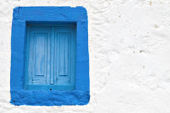 Traditional Greek house with blue shutters Stock Images