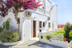 Traditional Greek house with bougainvillea flowers in Thira, Santorini, Greece Royalty Free Stock Photos
