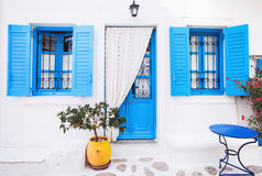 Traditional greek house facade, Greece. Blue door and blue window, traditional greek village Stock Image
