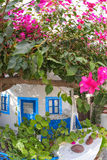 Traditional greek house with flowers in Oia village on Santorini island, Greece Royalty Free Stock Photography