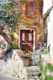 Traditional Greek House with Olive Tree. A typical greek  house facade in Kavala,Greece Stock Photos