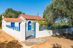 Traditional greek house Skiathos. Old traditional house with blue door and windows in Skiathos Greece September 2018 stock image