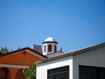 Traditional Greek houses. Closeup of rooftops of traditional Greek houses under blue sky Stock Photography