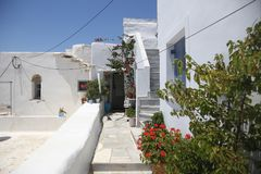 Typical greek island street in Tinos, Greece Stock Image