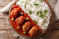 Traditional Greek meatballs in tomato sauce with rice close-up o. N a plate on a table. horizontal top view from above royalty free stock photo