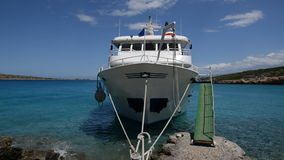 The traditional Greek motor yacht for tourists transportation is near beach. Crete, Greece stock video