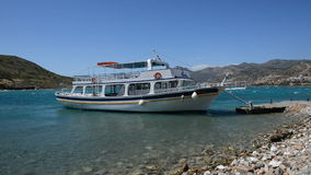 The traditional Greek motor yacht for tourists transportation at Spinalonga island stock video