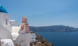 Belltower and bells on Greek Orthodox church in Oia stock images
