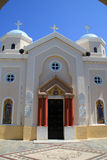 Traditional Greek orthodox church on Greek Island. Greek Orthodox church with domes,pillars and crosses on Greek Island royalty free stock photo
