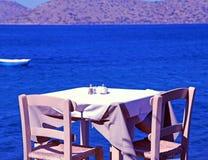 Traditional greek outdoor restaurant (Crete, Greece ). Royalty Free Stock Image
