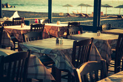 Traditional greek outdoor restaurant on terrace Stock Images