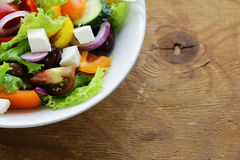 Traditional Greek salad with feta cheese, tomatoes, olives and lettuce Royalty Free Stock Photography