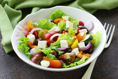 Traditional Greek salad with feta cheese, tomatoes, olives and lettuce Royalty Free Stock Images