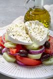 Traditional greek salad made with fresh cucumber, tomato, paprika, red onion, kalamata olives, white salted feta cheese with. Oregano served with olive oil royalty free stock image