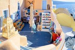 Traditional greek souvenir store in Oia town of Santorini island, Greece Stock Photos
