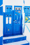 Traditional Greek stone house, blue gate and window shutters, Santorini island, Greece. Royalty Free Stock Images