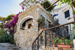 Traditional Greek stone house with  purple bougainvillea flowers on Crete island Royalty Free Stock Photography