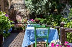 Traditional greek street cafe Stock Photo