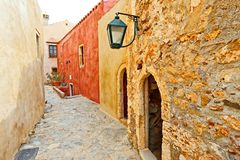 Traditional greek street in monemvasia. Greece monemvasia traditional street in main capitol in mani Peloponnese with sea background stock photo