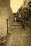Traditional greek street vintage postcard. Greece monemvasia traditional street in main capitol in mani Peloponnese with sea background stock photography