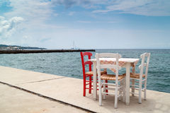 Traditional Greek table at the beach Royalty Free Stock Photo