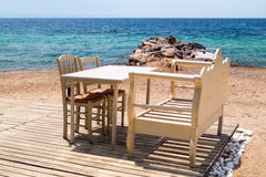 Traditional Greek table at the beach Stock Photography