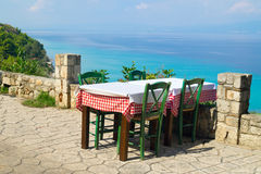 Traditional Greek table at the beach Stock Photo